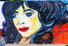 Photo of Homenajean a policía asesinada con su rostro en un mural