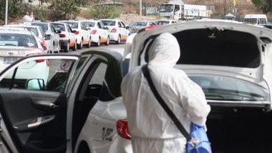 Photo of Transportistas de la garita San Ysidro sanitizan unidades